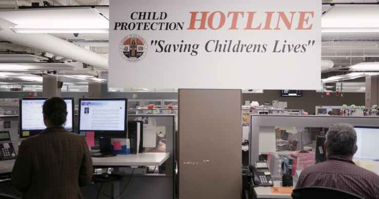 5f1bc22e673cf68b819ffe8e3c3a12f2d603aca6_foster_still_015_children-protection-hotline-sign